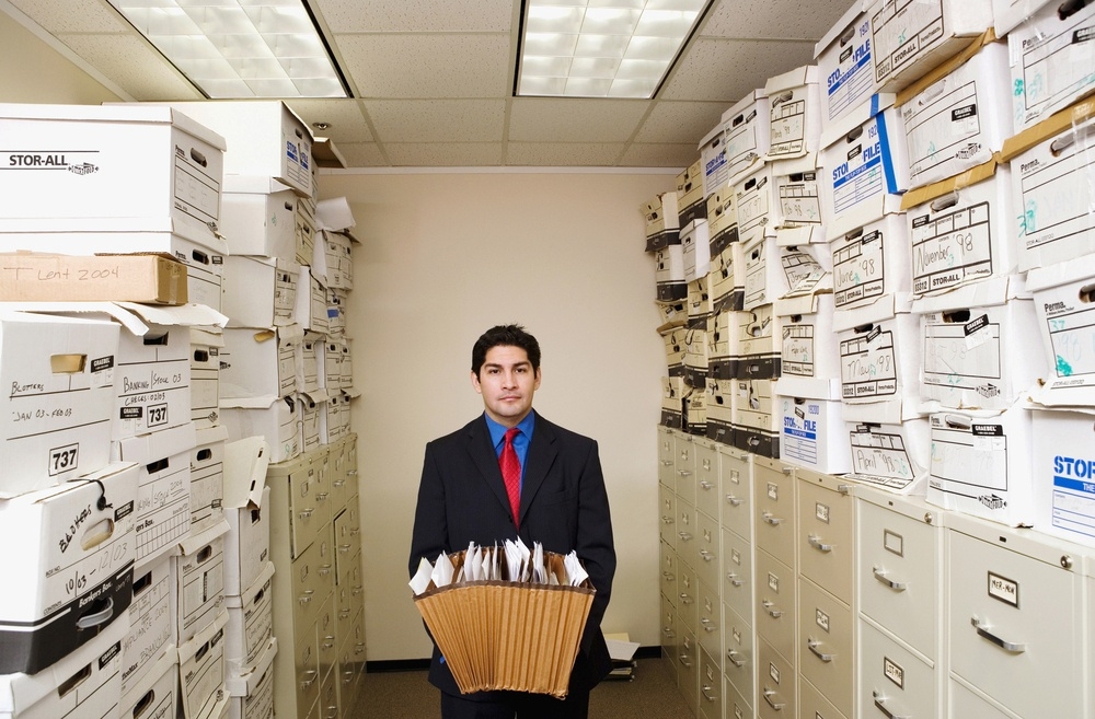 What is the cost to scan documents stored in file cabinets and cardboard boxes?